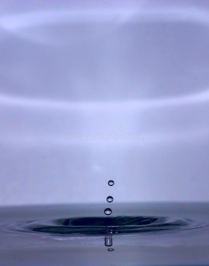 De Druppels van de Daling van het water stock afbeelding