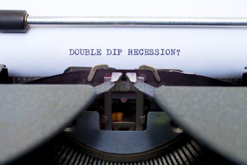 De dubbele Recessie van de Onderdompeling die op een Oude Schrijfmachine wordt getypt royalty-vrije stock foto