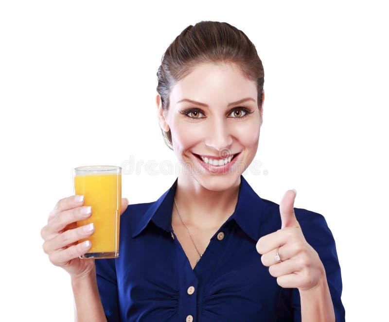 De duimen op drinken sinaasappel stock afbeelding