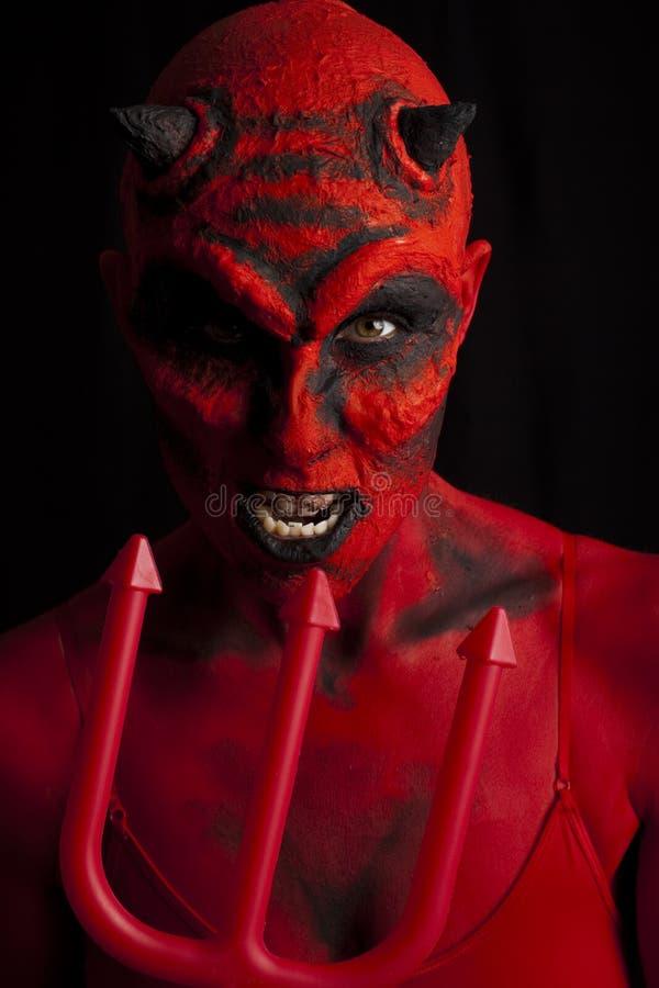 De duivel en de drietand. royalty-vrije stock afbeeldingen