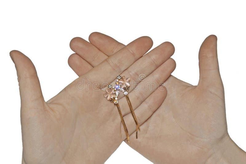 De Dure Gouden Juwelen van de handholding royalty-vrije stock afbeelding
