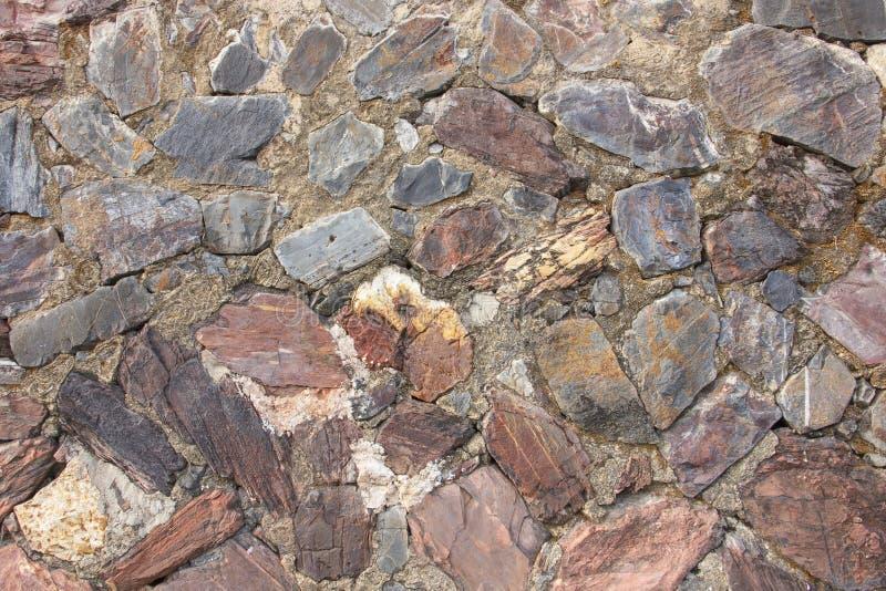 De echte middeleeuwse oppervlakte van de steenmuur kan als achtergrondpatroon of textuur bij oude stad gebruiken stock afbeeldingen