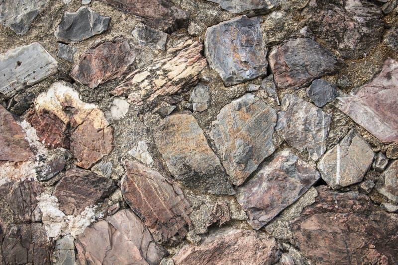 De echte middeleeuwse oppervlakte van de steenmuur kan als achtergrondpatroon of textuur met echt licht bij oude stad Songkhla Th royalty-vrije stock afbeelding