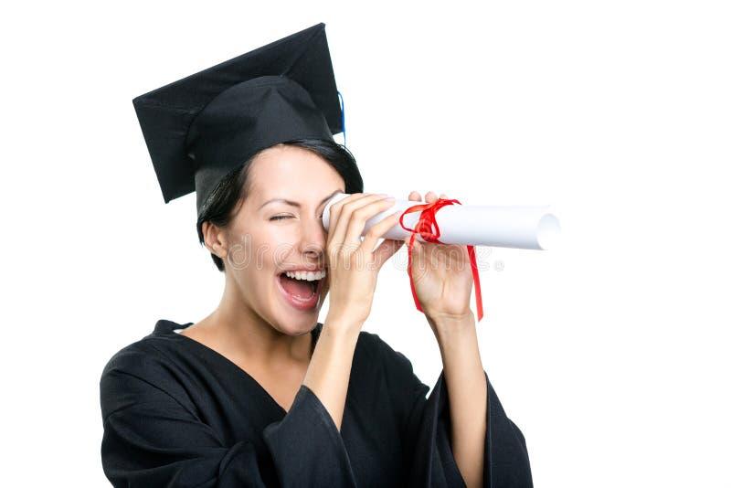 De een diploma behalende student houdt certificaat stock foto's