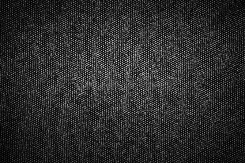 De eenvoudige zwarte textuur van de achtergrondjutestof met grijze gradiënt lichte samenvatting voor product of tekstachtergrondo royalty-vrije stock afbeeldingen