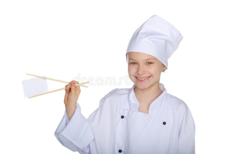De eetstokjes blanco pagina van de chef-kokholding stock fotografie