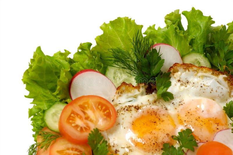 De eieren van de kip met geïsoleerdr greens stock afbeelding