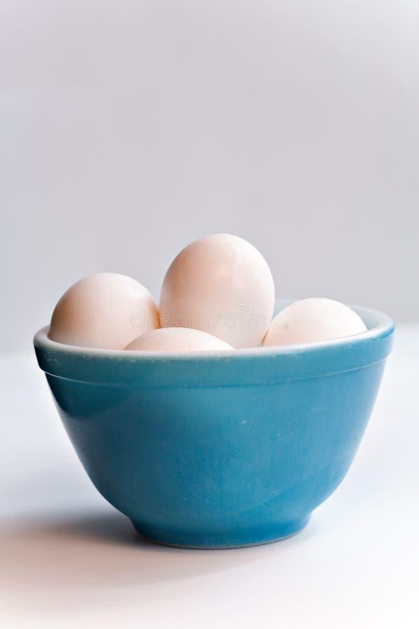 De Eieren van de kom stock foto