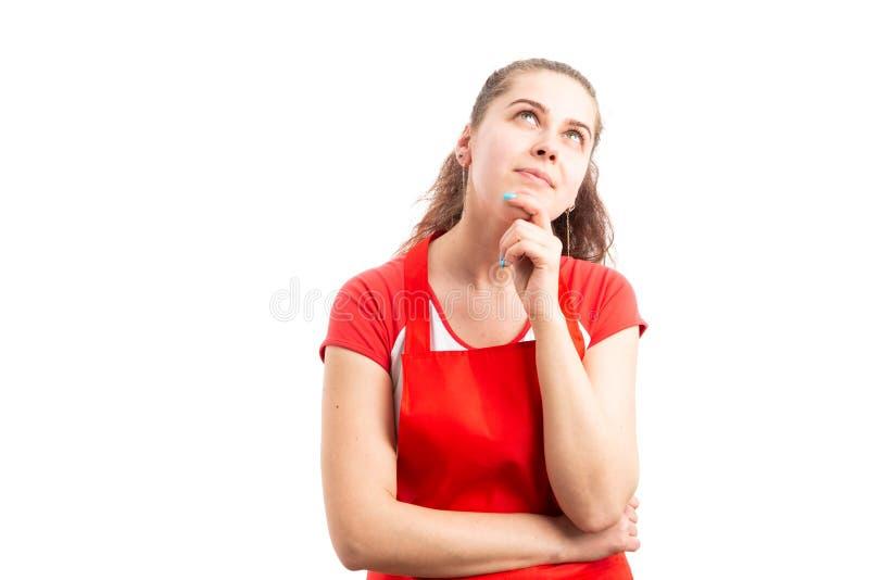 De eigenaar die van de vrouwenwinkel het veronderstellen van gebaar maken royalty-vrije stock afbeelding