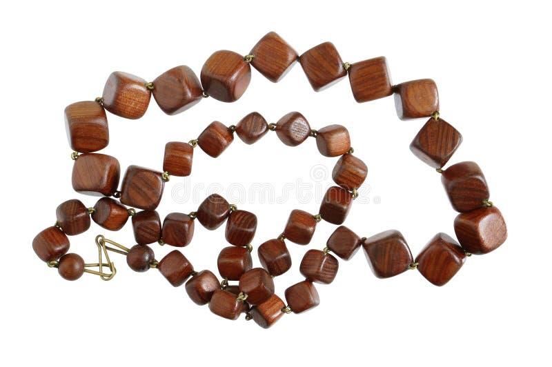 De eigengemaakte vrouwelijke parels worden gemaakt van ebbehout en mahonie houten s royalty-vrije stock foto's