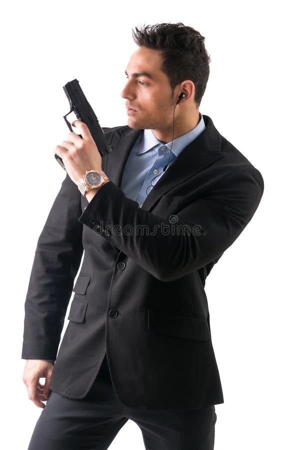 De elegante mens met kanon, kleedde zich als spion of geheim royalty-vrije stock afbeelding
