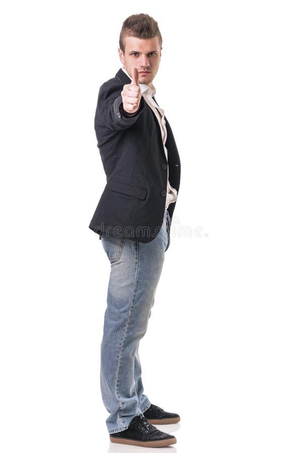 De elegante mens met kanon, kleedde zich als spion of geheim stock foto