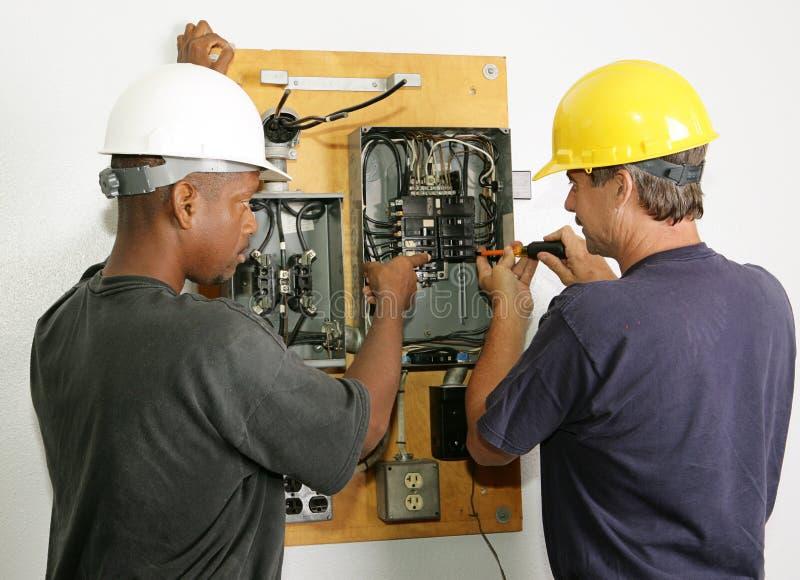 De elektriciens herstellen Comité royalty-vrije stock fotografie