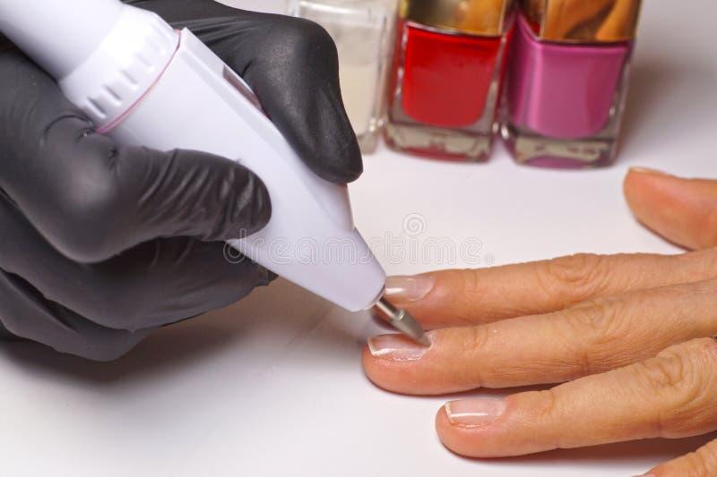 De elektrische machine van de spijkerboor Het apparaat voor de snijder van het manicuremalen voor hardwaremanicure, een pedicure  royalty-vrije stock afbeeldingen