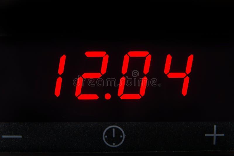 De elektronische klok 12 04 stock afbeeldingen