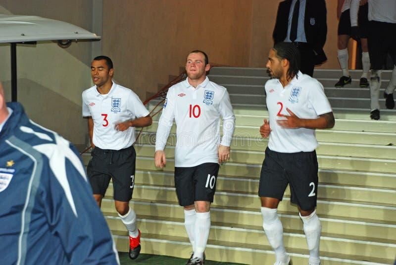 De Engelse spelers gaan het gebied in stock fotografie