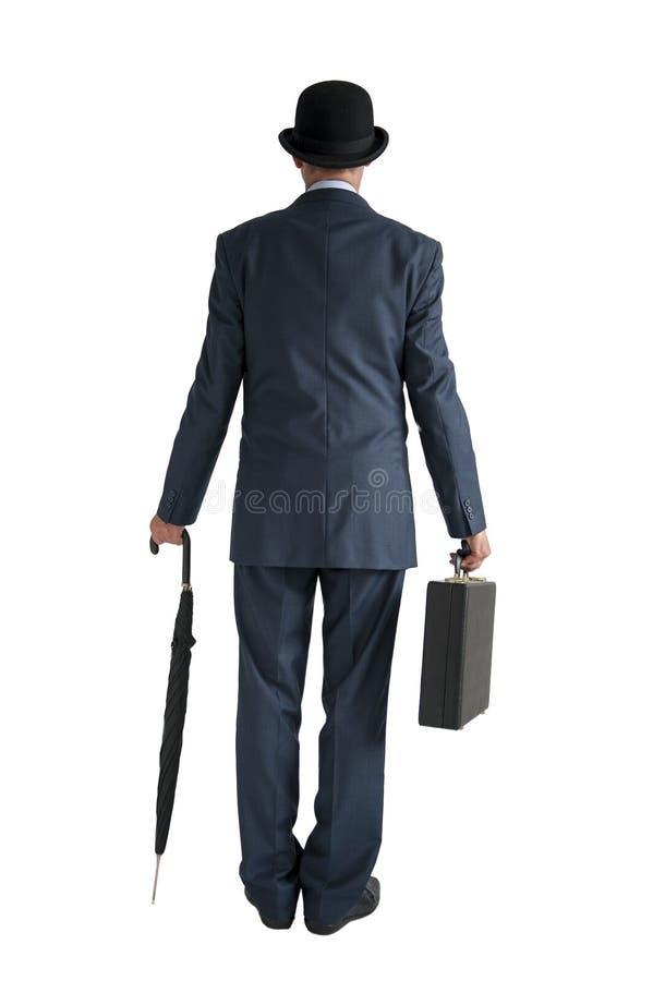 De Engelse zakenman met bowlingspelerhoed en paraplu isoleerde wit stock foto's