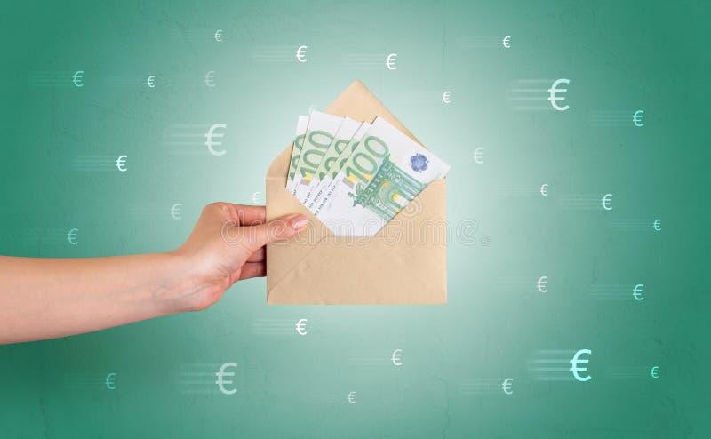 De envelop van de handholding met rond symbolen stock afbeelding