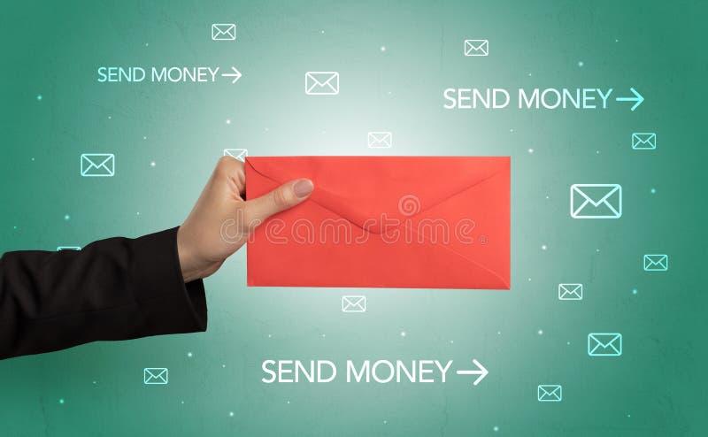 De envelop van de handholding met rond symbolen stock foto's