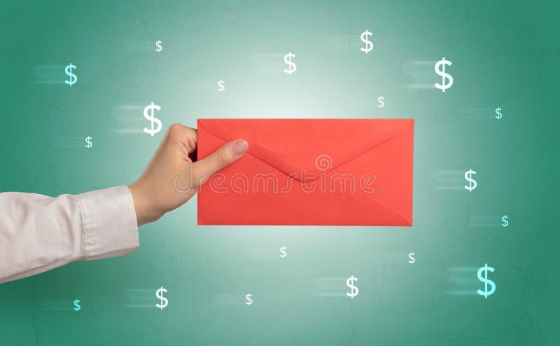 De envelop van de handholding met rond symbolen royalty-vrije stock foto's