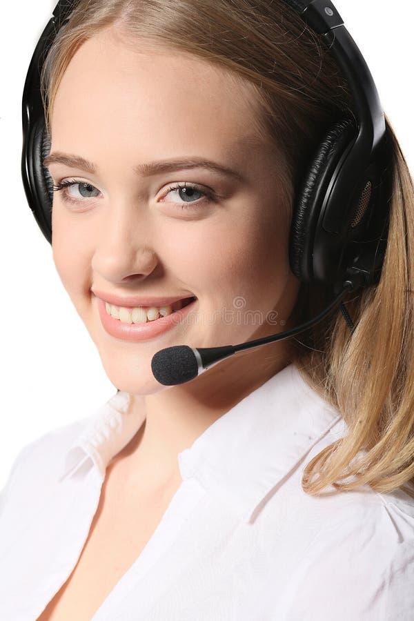 De exploitant van de steuntelefoon in hoofdtelefoon, op wit wordt geïsoleerd dat stock fotografie