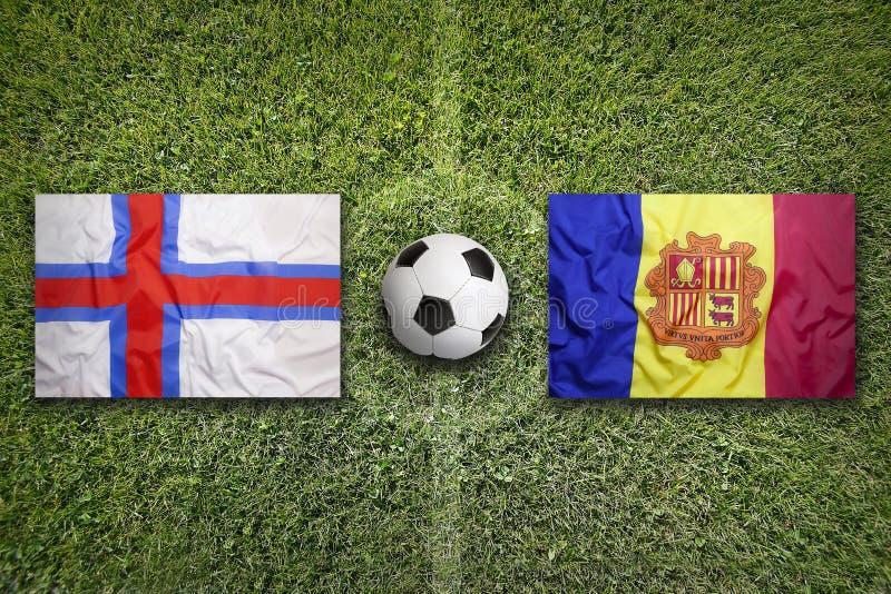 De Faeröer versus De vlaggen van Andorra op voetbalgebied royalty-vrije stock foto's