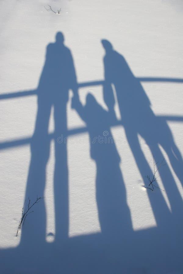 De familieschaduw van de winter royalty-vrije stock foto