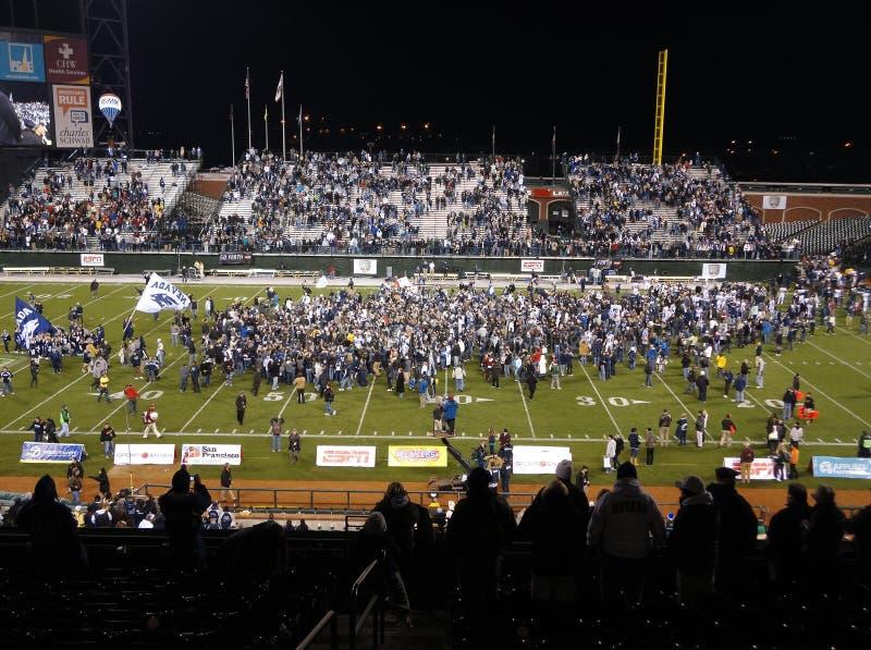 De Fan UNR juicht toe aangezien de spelers en de fans gebied vieren stock foto