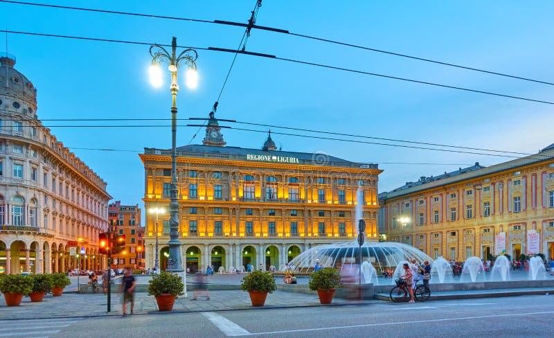 De Ferrari square in Genoa. Genoa, Italy - June 30, 2019: De Ferrari square with the fountains in Genoa at twilight, Liguria royalty free stock photo