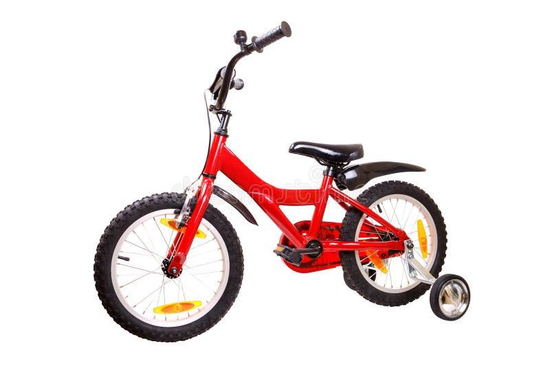 De fiets van nieuwe rode kinderen op wit stock foto's