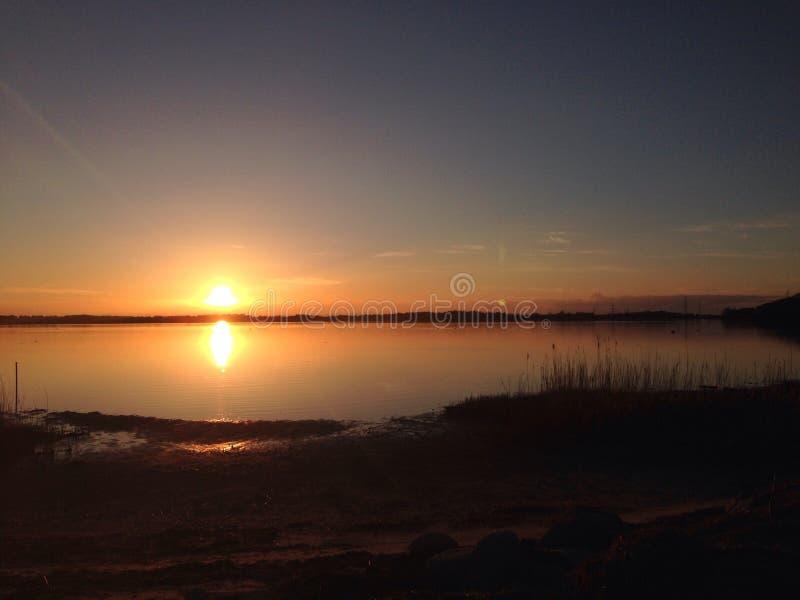 De fjord van zonsondergangroskilde stock foto