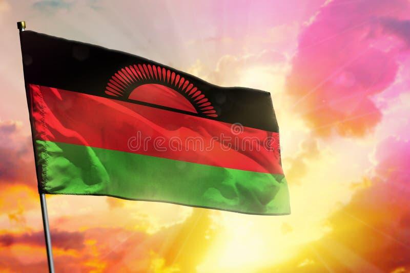 De fladderende vlag van Malawi op mooie kleurrijke zonsondergang of zonsopgangachtergrond Verschillende 3d bal royalty-vrije stock foto's