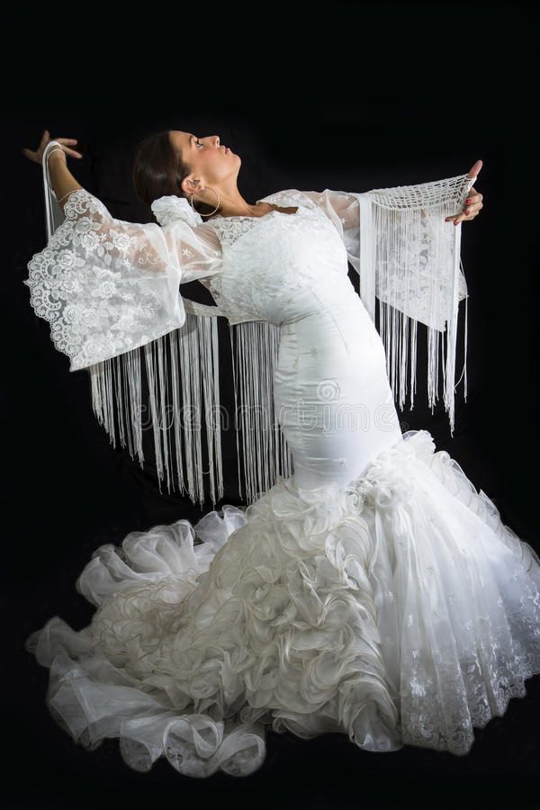De flamencodanser kleedde zich in wit met uitdrukking royalty-vrije stock afbeeldingen