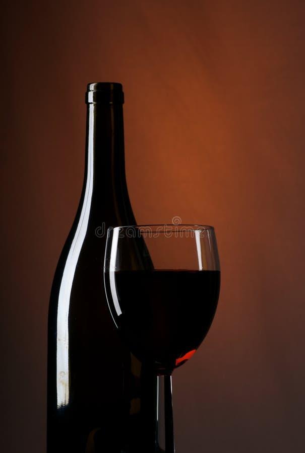 De Fles en het Glas van de wijn stock foto's