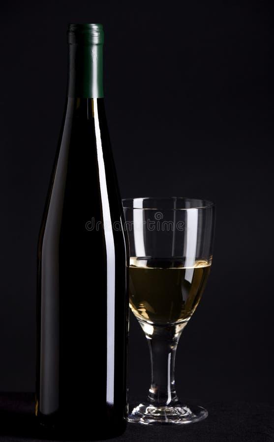 De Fles en het Glas van de wijn stock foto
