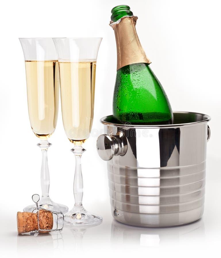 De fles van Champagne in koeler royalty-vrije stock foto