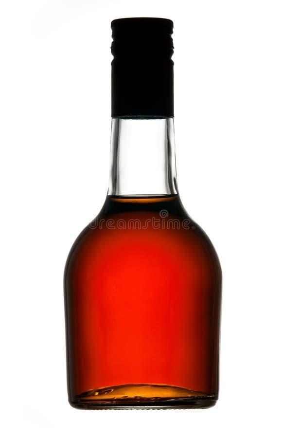De fles van de cognac stock afbeelding