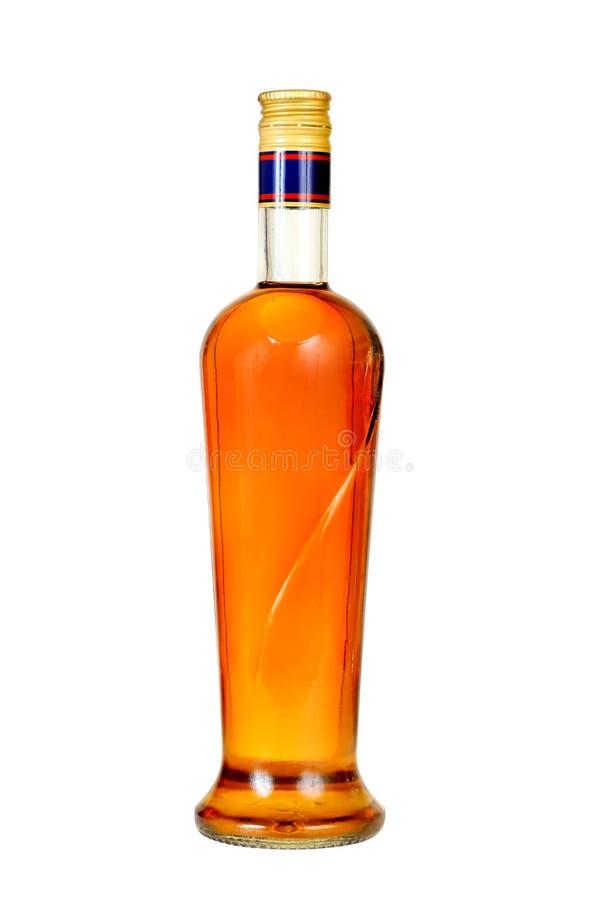De fles van de cognac. stock afbeeldingen