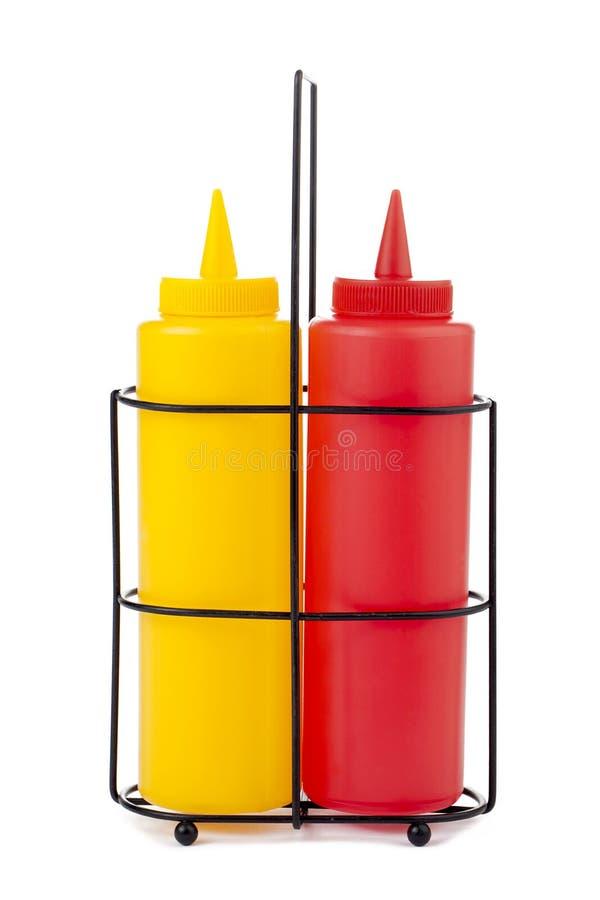 De fles van de mosterd en van de ketchup stock fotografie
