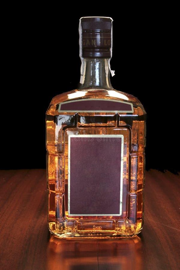 De fles van de whisky stock afbeelding