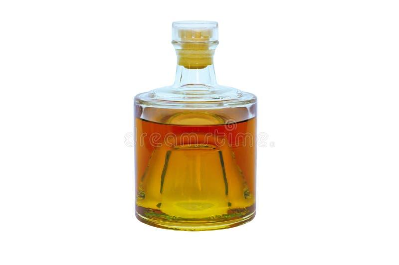 De fles van het glas met alcohol stock foto's