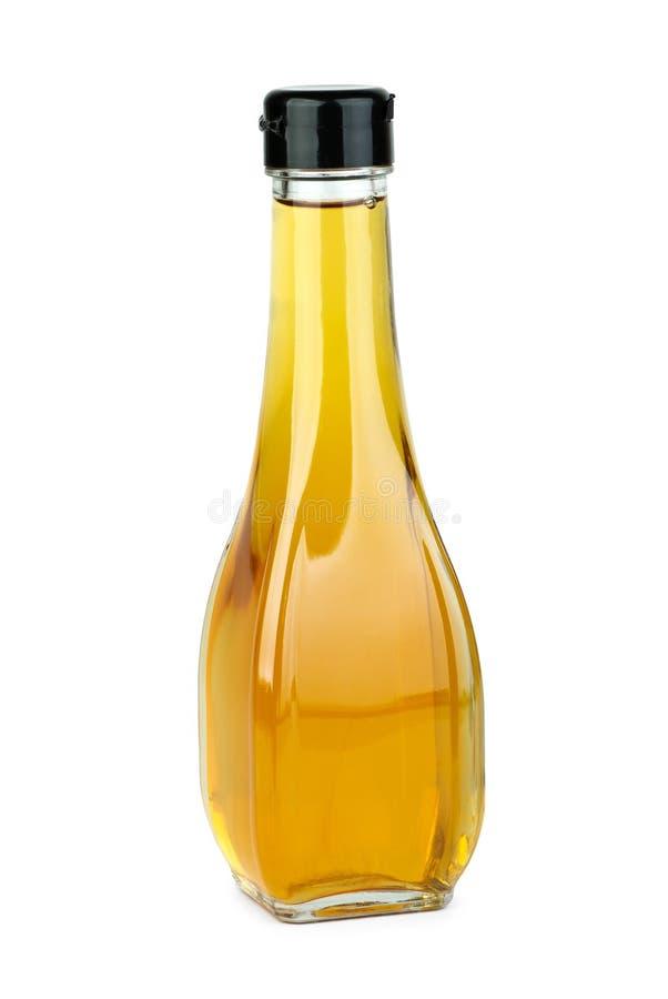 De fles van het glas met appelazijn royalty-vrije stock afbeeldingen