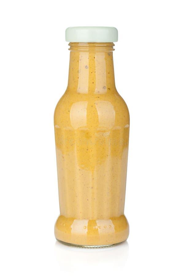 De fles van het mosterdglas stock foto