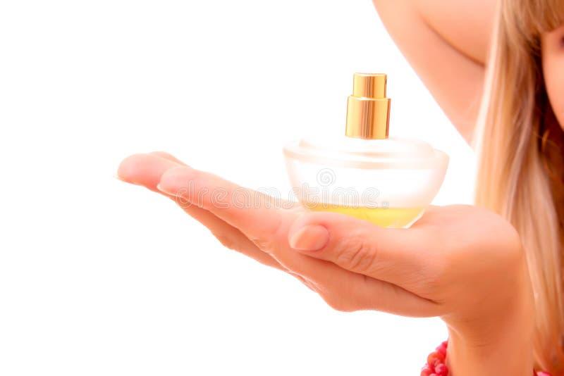 De fles van het parfum op geïsoleerder hand stock foto