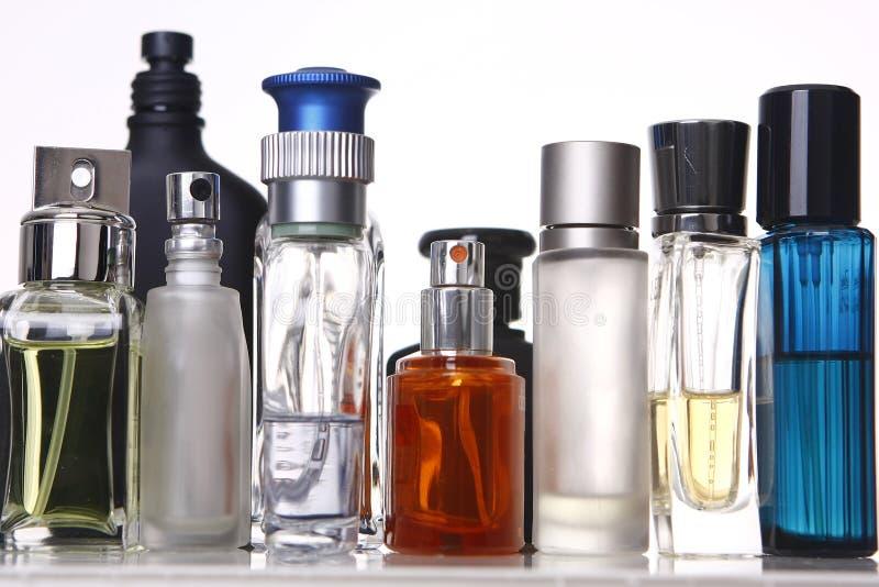 De Flessen van het parfum en van de Geur stock afbeeldingen