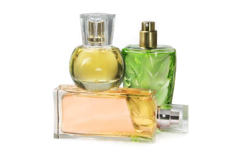 De flessen van het parfum op witte achtergrond royalty-vrije stock afbeeldingen