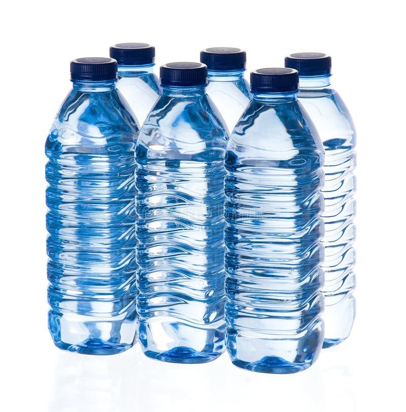De flessen van het water stock foto