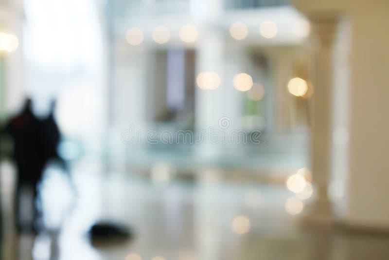 De-focuses business center interior. Blur background royalty free stock image