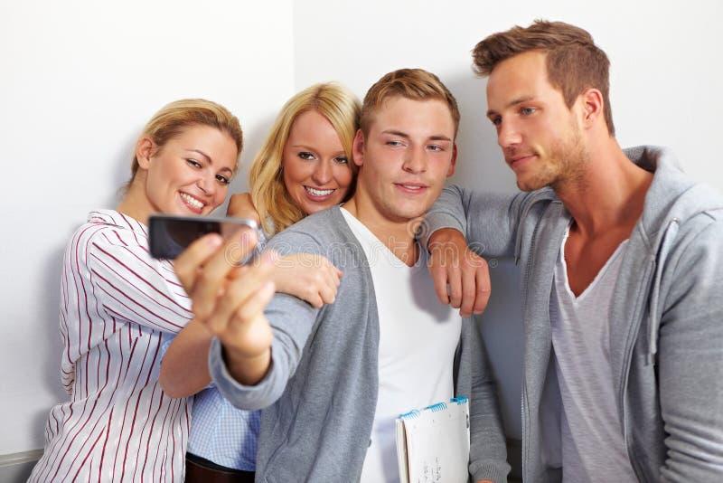 De foto van de groep met celtelefoon royalty-vrije stock afbeelding
