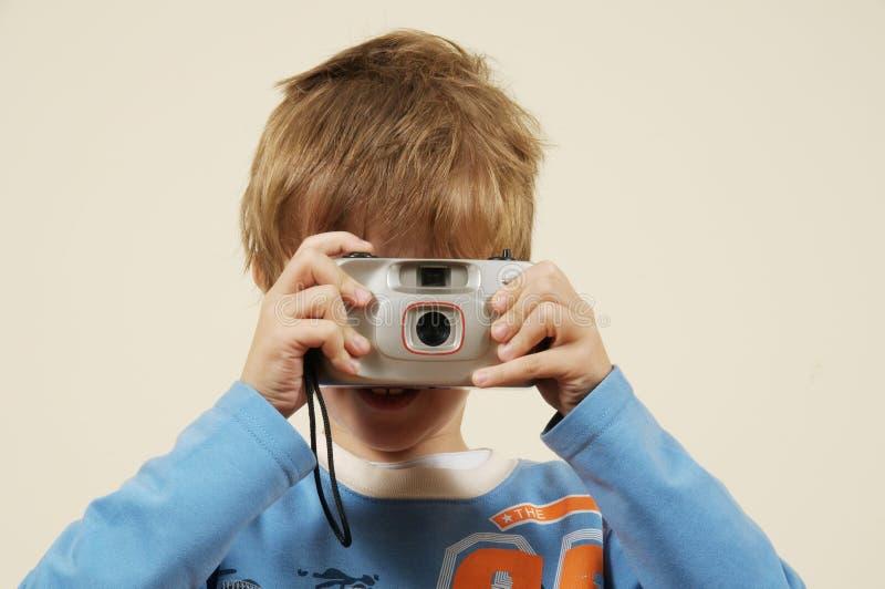 De fotograaf van de jongen stock fotografie